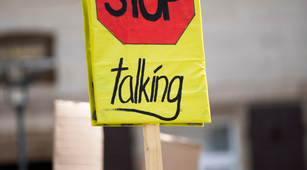 "Toward Healthy Dissent (Person Holding a Sign that says ""Stop Talking"")"