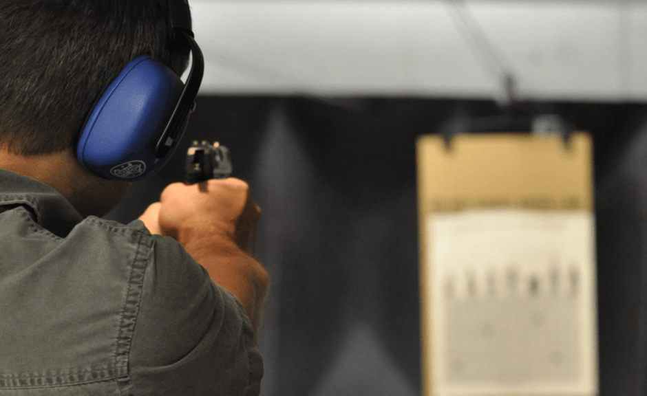 Man at shooting range aims at target--introducing an article about Evangelicalism and militant masculinity