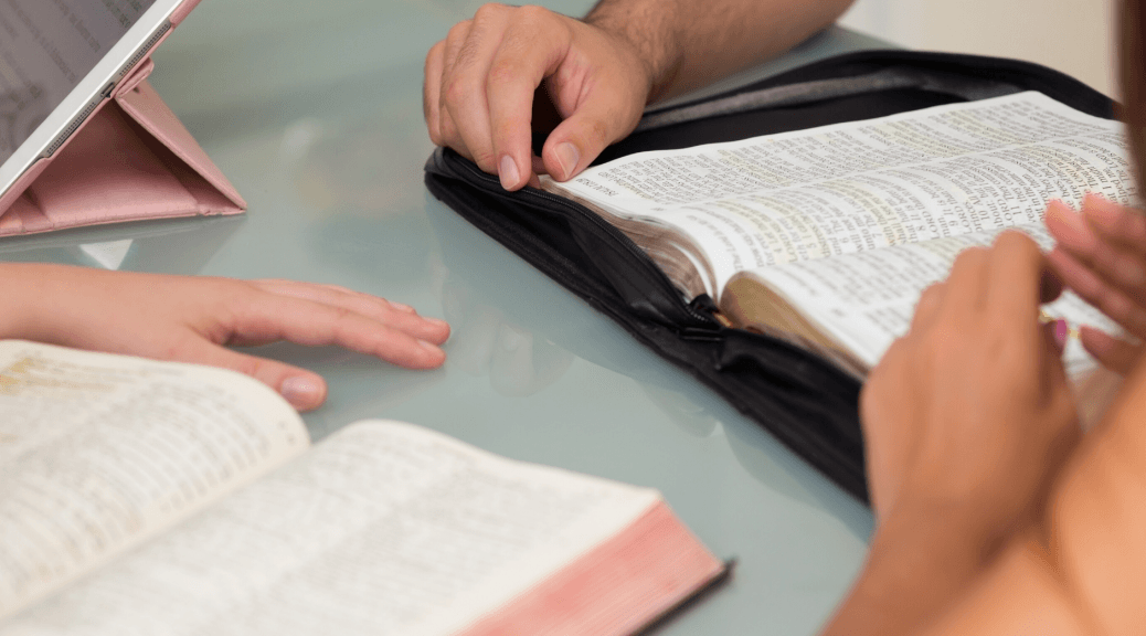 Shows people with Bibles as an illustration for an analysis of religious rhetoric