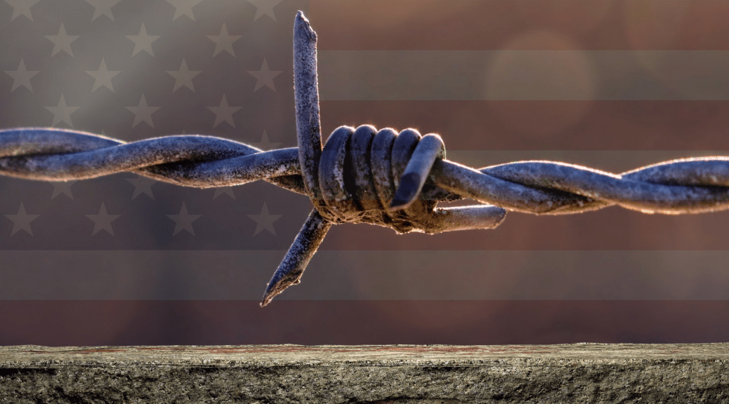 Image of barbed wire in front of a flag to go with an article about the unhealthy rhetoric of the Patriot Movement