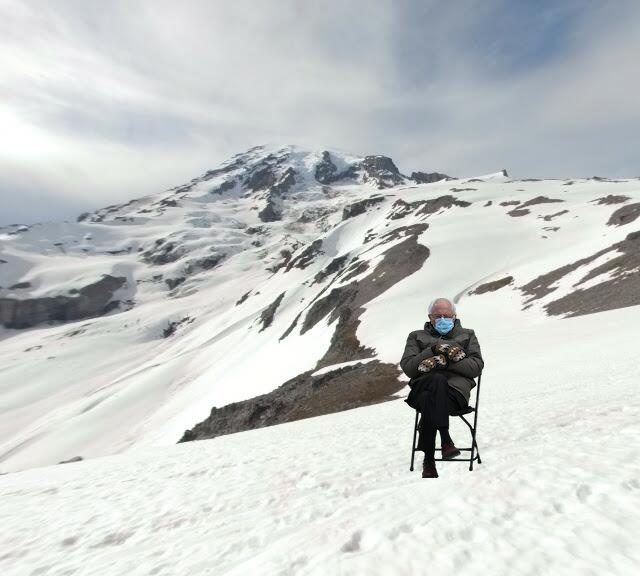 An example of #BernieMemes with Bernie Sanders sitting on Mt. Rainier