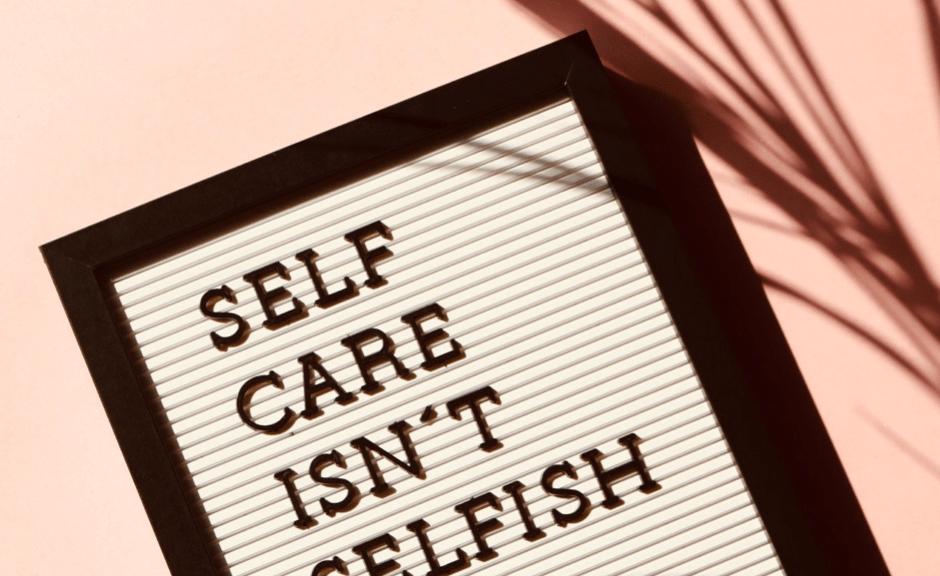 """Message board reading """"self care isn't selfish"""""""
