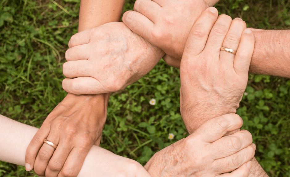 Image showing a mass of handing holding one another in support